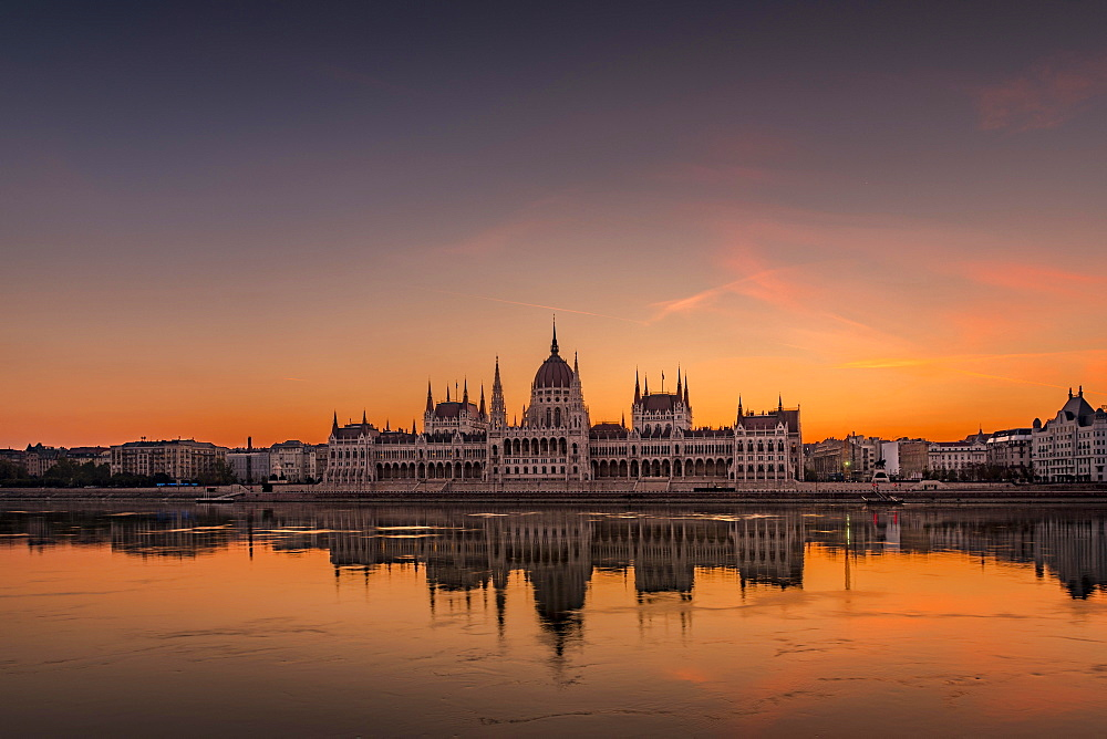 Sunrise with Parliament and water reflection in the Danube, Budapest, Hungary, Europe