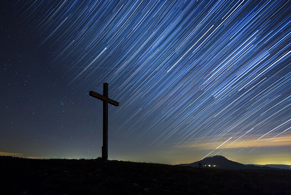 Summit cross on Bisberg Mountain with a starry sky, Hohenhewen Mountain at the back, Tengen, Watterdingen, Hegau, Baden-Wurttemberg, Germany, Europe