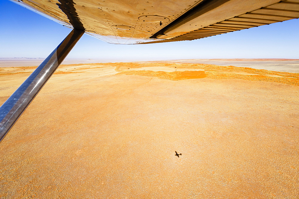 Aerial view, shadow of small aircraft on the ground, Namib Desert, Namib-Naukluft National Park, Namibia, Africa - 832-383155
