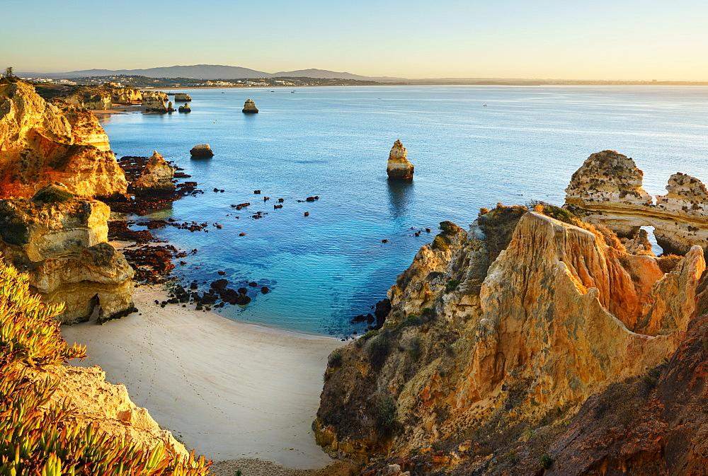Beach and rocky coast Praia do Camilo, morning mood, Lagos, Algarve, Portugal, Europe