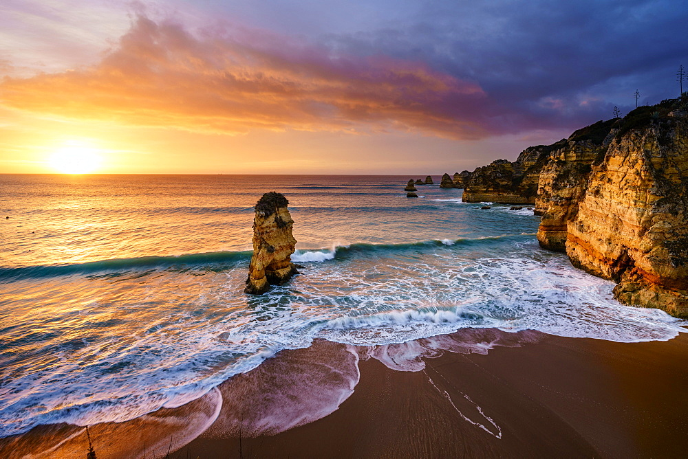 Sunrise on the beach Praia da Dona Ana, Lagos, Algarve, Portugal, Europe