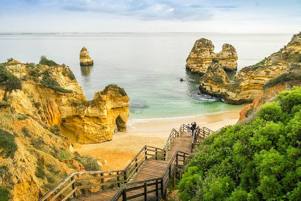 Camilo Beach with wooden walkway to the sandy beach, Lagos, Algarve, Portugal, Europe