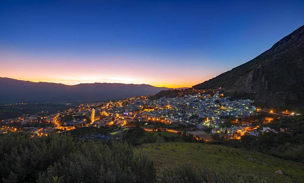 View of illuminated city Chefchaouen at sunset, Chaouen, reef mountains, Tangier-Tetouan, Morocco, Africa