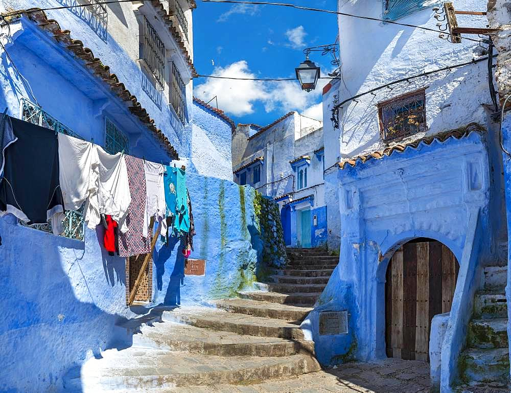 Stairs through narrow alley, blue houses, medina of Chefchaouen, Chaouen, Tanger-Tetouan, Morocco, Africa