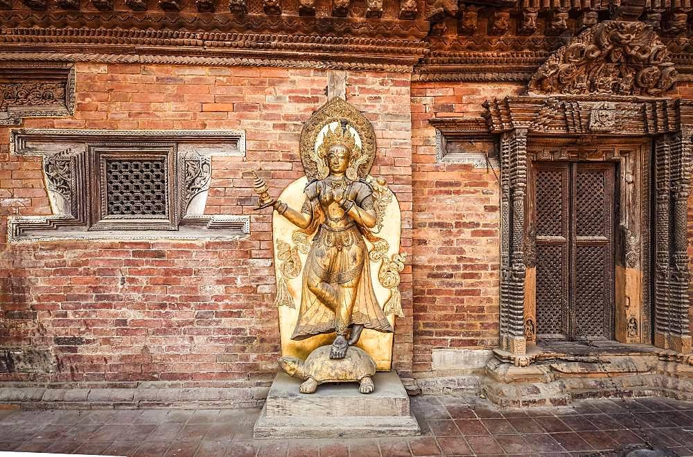 Buddhist deity, golden statue, temple, Patan, Kathmandu valley, Himalaya region, Nepal, Asia