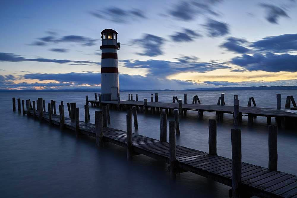 Lighthouse at the footbridge at dusk, Podersdorf, Burgenland, Austria, Europe