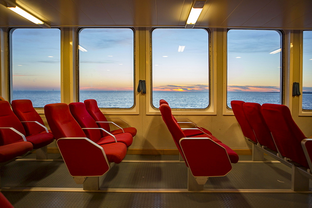 Red benches of a car ferry across the Gironde at sunset, Royan, Medoc, Gironde, France, Europe