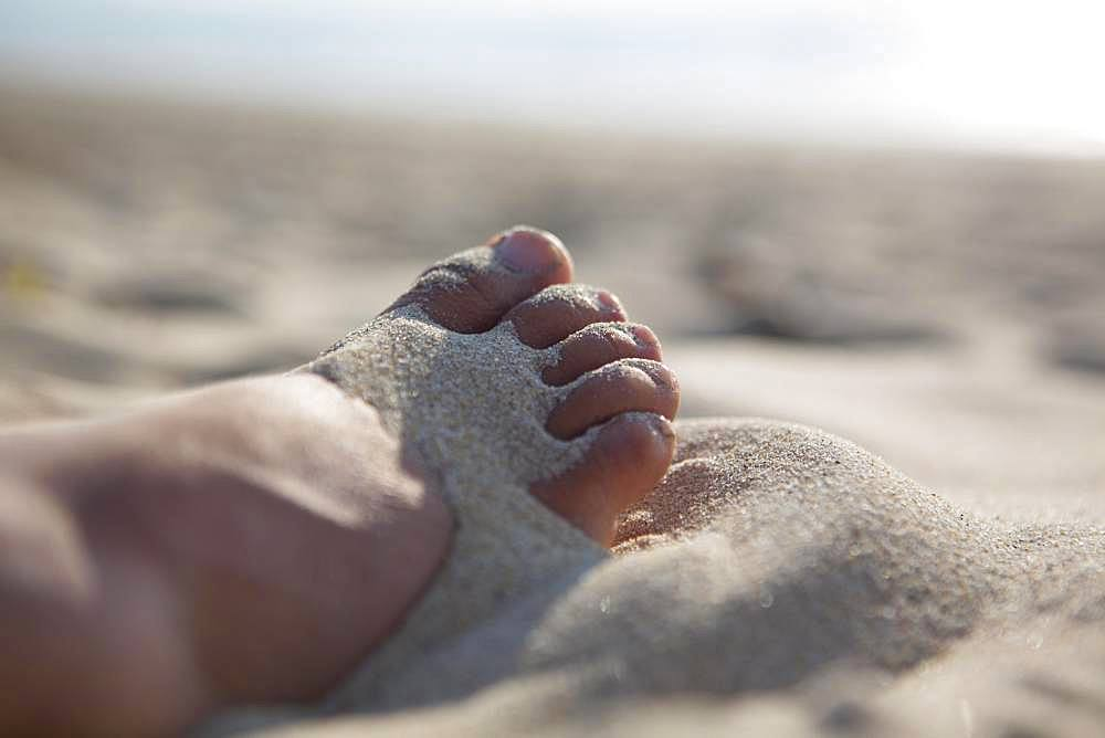 Foot in the sand on the sandy beach, Gurp Plage, Grayan-et-l`Hopital, Aquitaine, Gironde, France, Europe