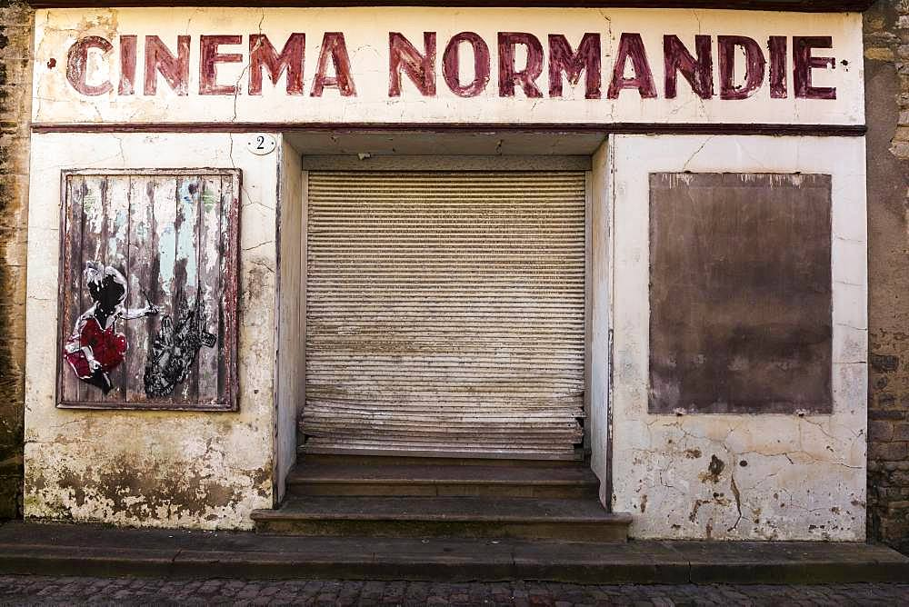 Expired entrance of a closed cinema in Bayeux, Normandy, France, Europe