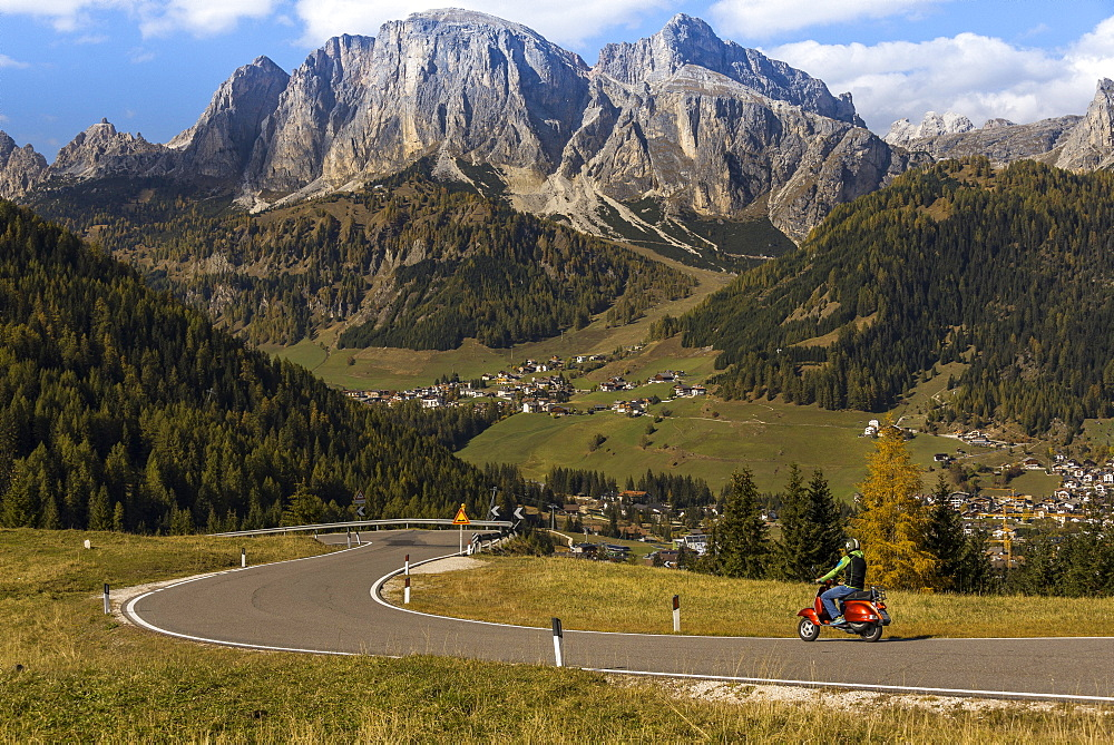 Motor scooter on winding road in autumn, Alta Batia, Hochabteital, autumn, Dolomites, South Tyrol, Italy, Europe