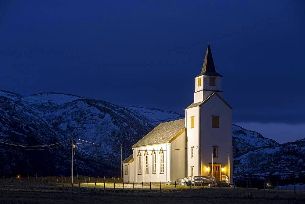 Illuminated church during blue hour, Brensholmen, Tromsoe, Troms, Norway, Europe
