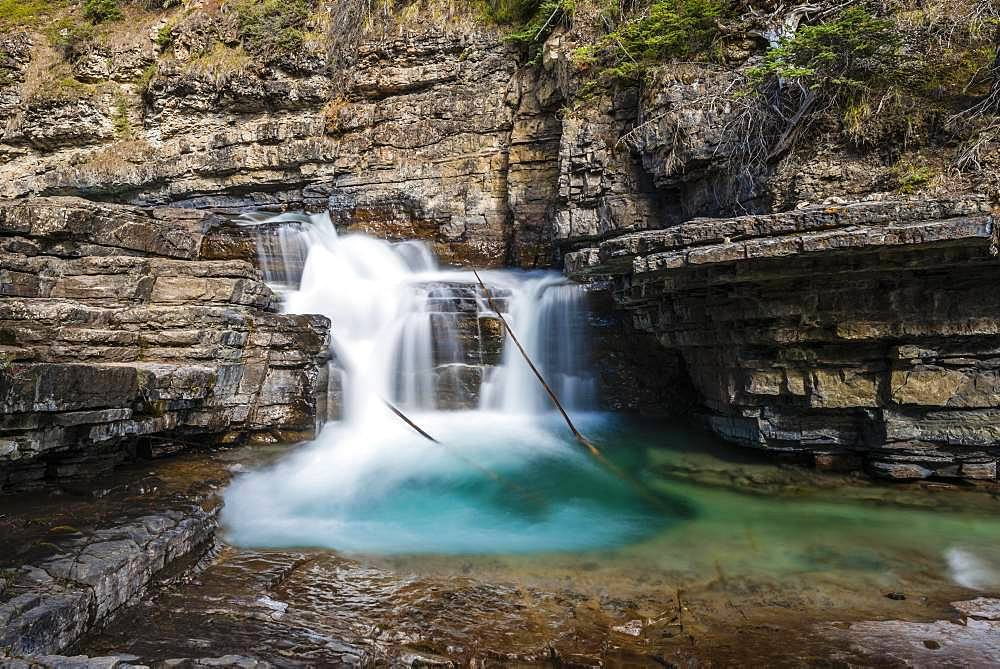Waterfall at a mountain river, Johnston Creek in Johnston Canyon, Bow Valley, Banff National Park, Rocky Mountains, Alberta, Canada, North America