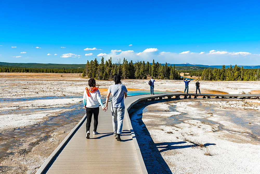 Two tourists on a jetty in the thermal area, hot spring, Grand Prismatic Spring, Midway Geyser Basin, Yellowstone National Park, Wyoming, USA, North America