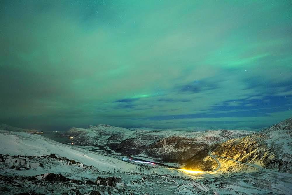 Northern Lights (aurora borealis), mountain landscape, winter landscape with view to the pass road on Jamnfjellet, Tromsoe, Norway, Europe
