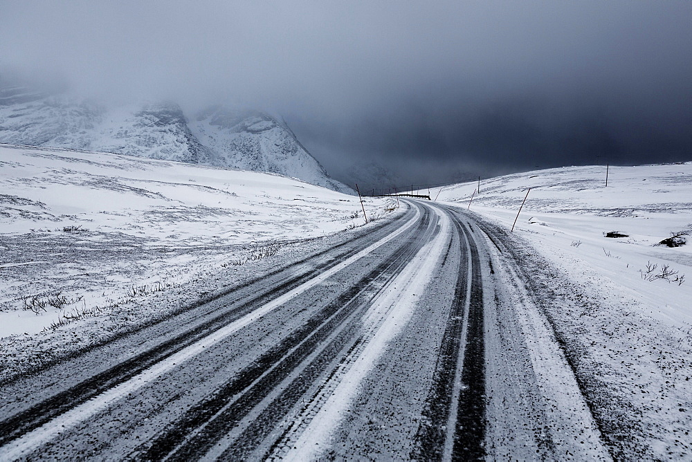 Winter storm, dark clouds above the pass road Rekvikvegen, Tromsoe, Norway, Europe