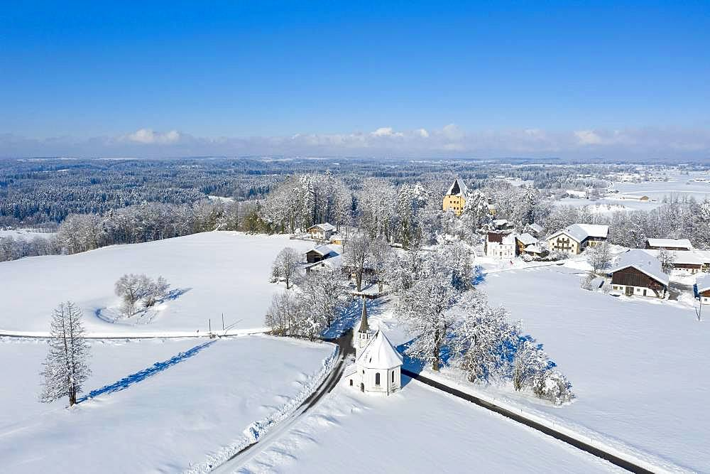 Harmarting with Castle Harmating and Chapel St. Leonhard in Winter, drone shot, Egling, Upper Bavaria, Bavaria, Germany, Europe