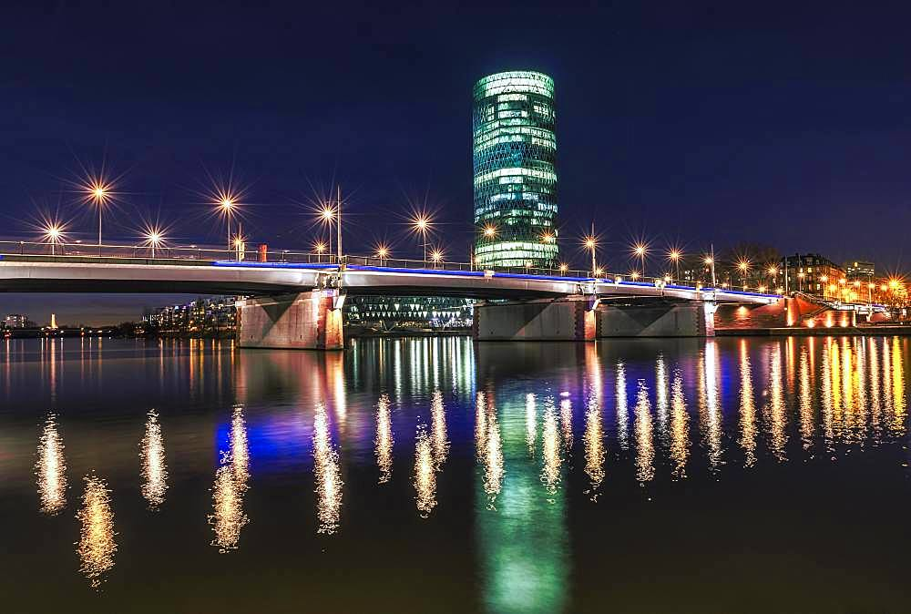 View of Friedensbruecke with Westhafen Tower, reflection of the lights in the Main, Schaumainkai, Frankfurt am Main, Hesse, Germany, Europe