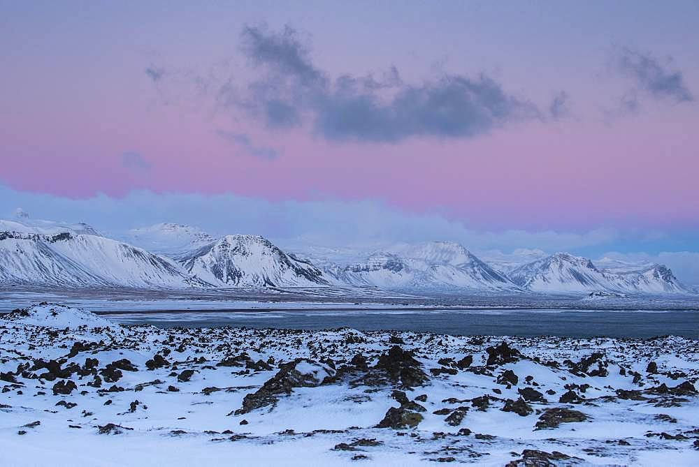 Snowy coastal landscape at dawn, south coast peninsula Snaefellsnes, Vesturland, Iceland, Europe