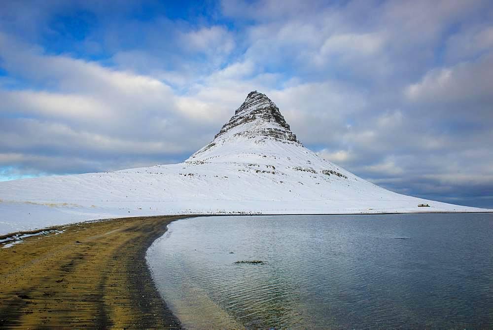 Mountain Kirkjufell with snow, peninsula Snaefellsnes, Vesturland, Iceland, Europe