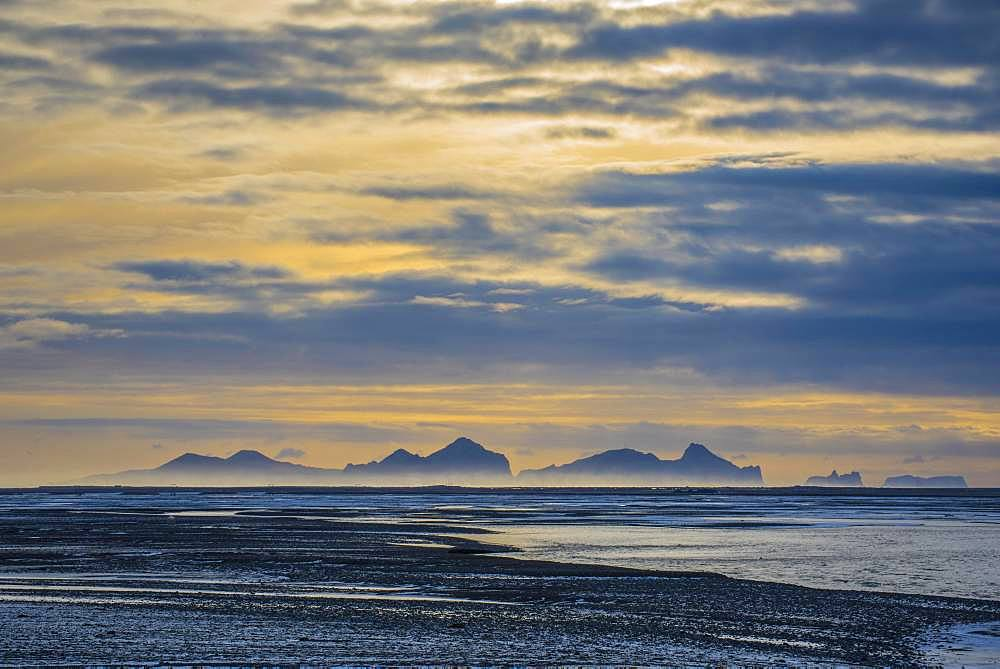 View from the mainland to the Westman Islands with cloudy sky, Vestmannaeyjar, Sudurland, Iceland, Europe