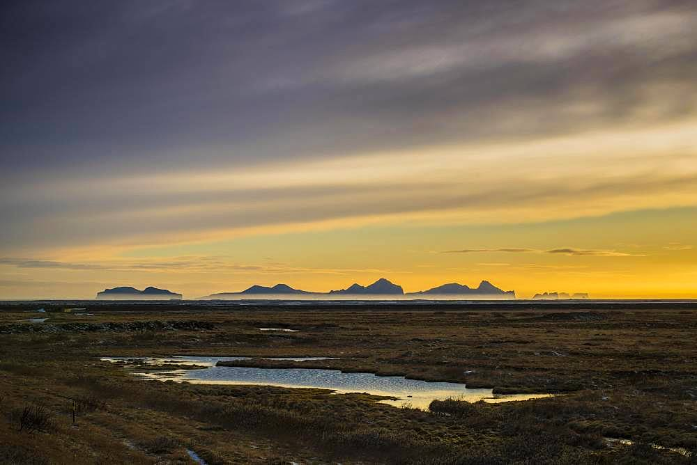 View from the mainland to the Westman Islands at sunset, Vestmannaeyjar, Sudurland, Iceland, Europe