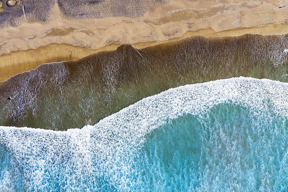 Waves running out at sandy beach, Playa Famara near Caleta de Famara, drone shot, Lanzarote, Canary Islands, Spain, Europe