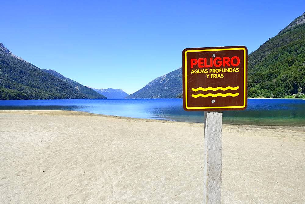 Sandy beach beach with warning sign, Attention deep and cold water, Lago Traful, Province Neuquen, Patagonia, Argentina, South America