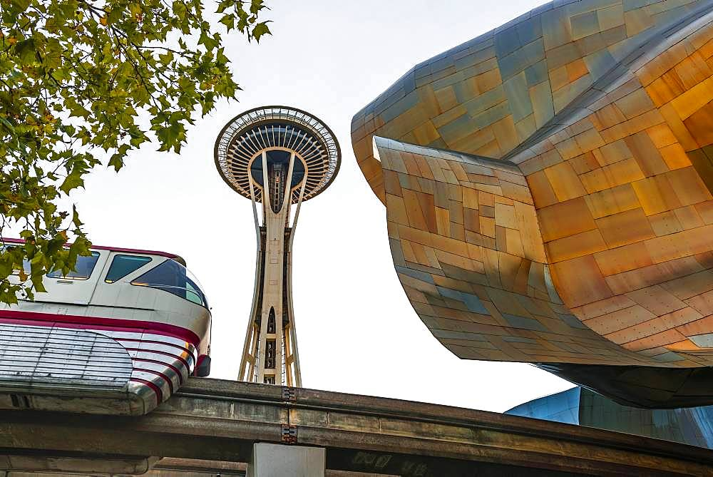 Monorail train runs through the Museum of Pop Culture, MoPOP, architect Frank Gehry, Space Needle, Seattle, Washington, USA, North America
