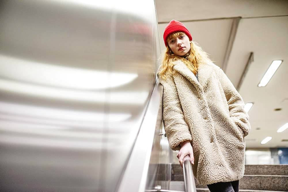 Girl, teenager, standing at the stairs of a subway station, Cologne, North Rhine-Westphalia, Germany, Europe