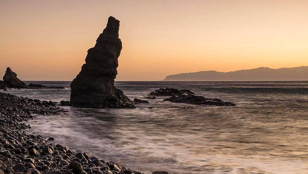 Beach Playa de Caleta with striking rocks and stones at sunrise, Playa de Caleta, La Gomera, Canary Islands, Spain, Europe
