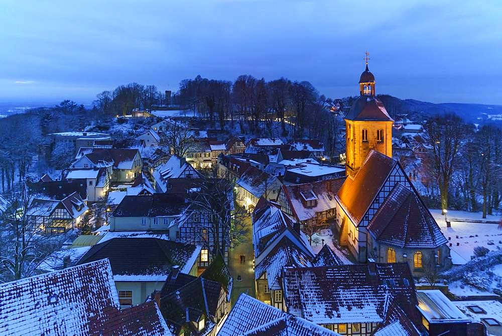 Protestant town church with old town of Tecklenburg in winter at the blue hour, Tecklenburg, North Rhine-Westphalia, Germany, Europe