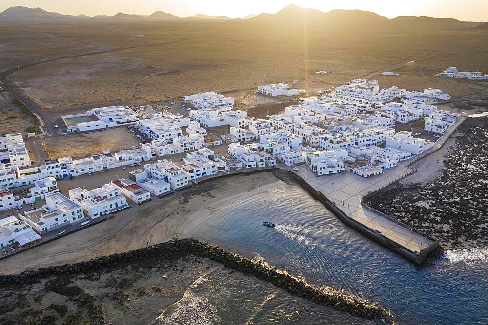 Caleta de Famara at sunset, drone shot, Lanzarote, Canary Islands, Spain, Europe