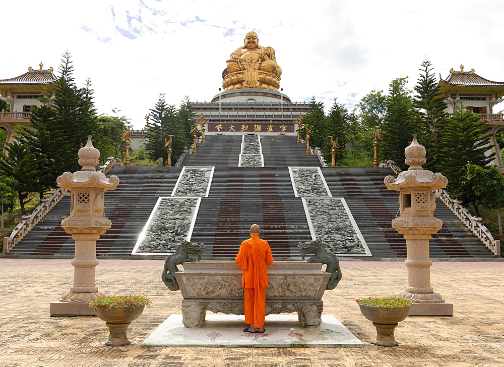 Happy Buddha, monk at an altar, Chiang Rai Province, Northern Thailand, Thailand, Asia