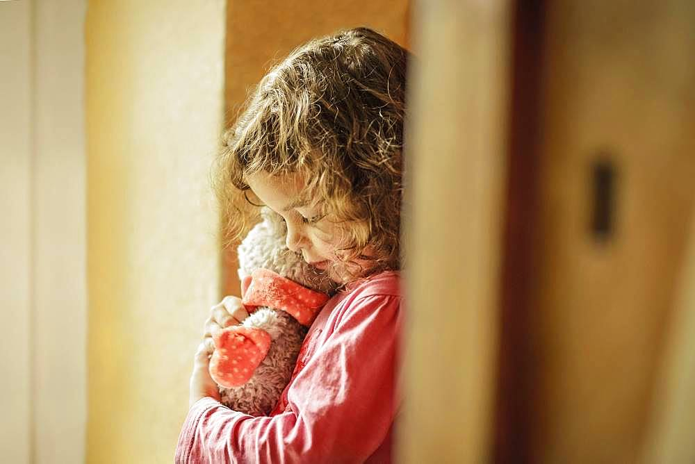Girl, 3 years, portrait, snuggles with teddy bear, Germany, Europe