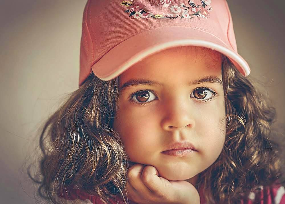 Girl, 3 years, portrait, direct view with peaked cap, Germany, Europe