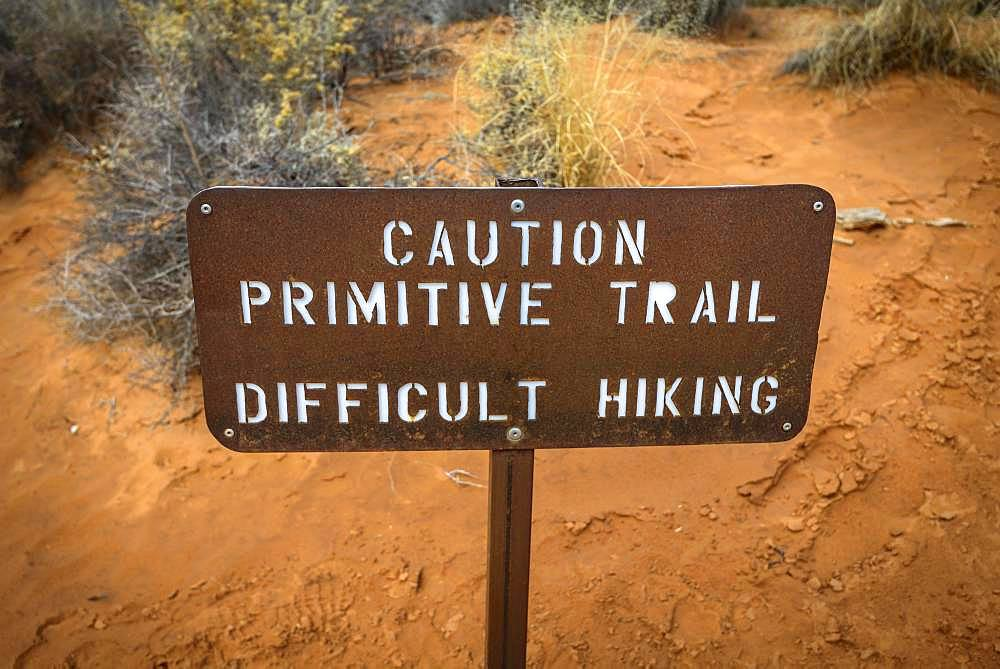Caution Primitive Train, Difficult Hiking, sign with warning of unsecured trail, Devil's Garden Trail, Arches National Park, Utah, USA, North America