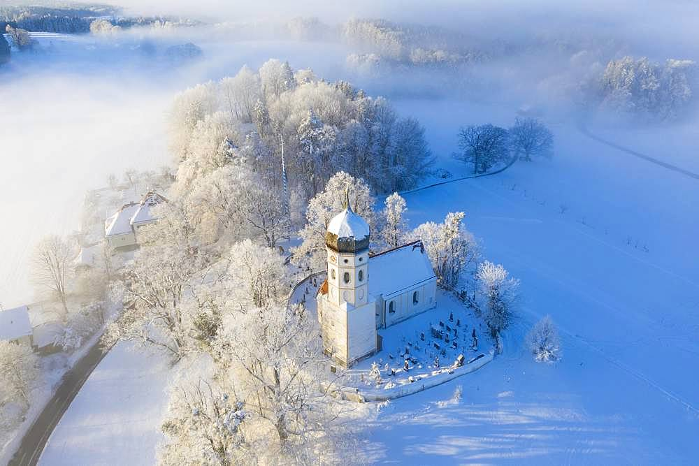 Snow-covered church St. Johann Baptist. Fog mood, Holzhausen near Muensing, Fuenfseenland, drone shot, Alpine foothills, Upper Bavaria, Bavaria, Germany, Europe