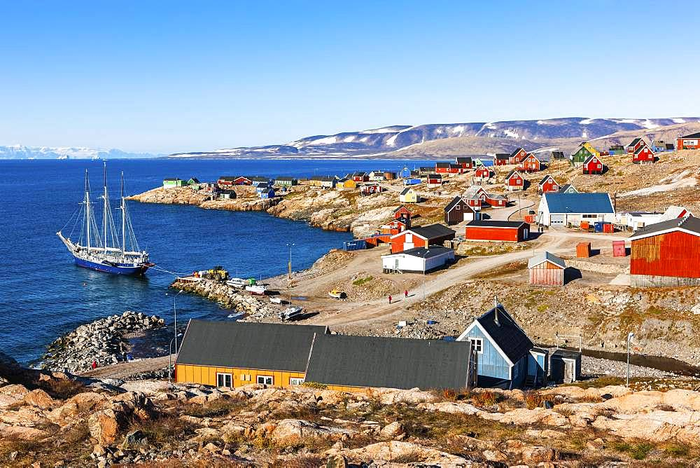 East Greenland town Ittoqqortoormiit with view to the harbour with sailboat, Scoresbysund, East Greenland, Greenland, North America