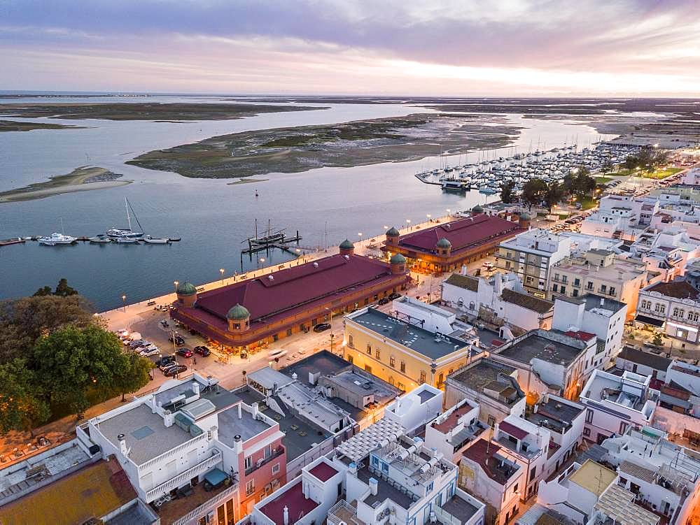 City view with two market buildings and and river Ria Formosa in the evening, Ria Formosa Natural Park, Olhao, Algarve, Portugal, Europe