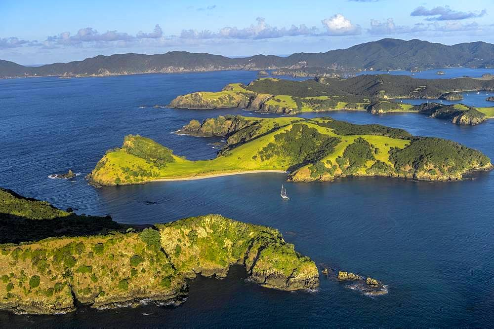 Aerial view of the Bay of Islands with islands and sailboat, Far North District, North Island, New Zealand, Oceania