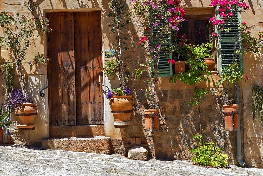 Traditional entrance with colourful flowers, Deia, Majorca, Spain, Europe