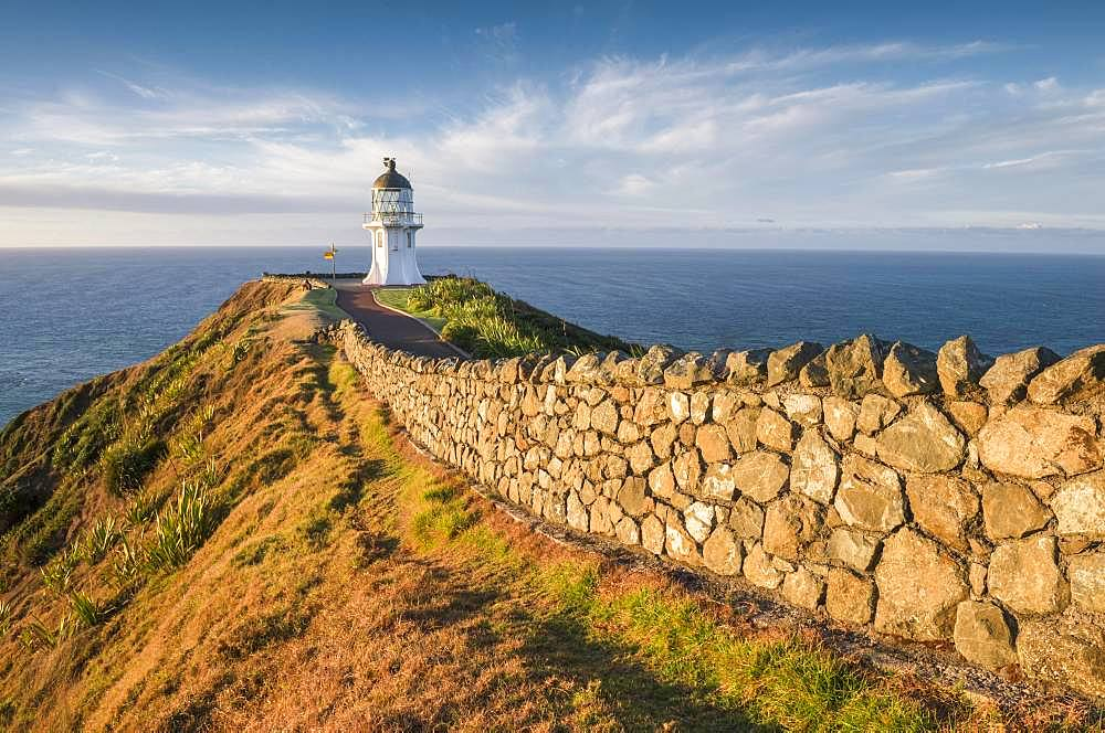 Away with stone wall leads to the lighthouse at Cape Reinga, Far North District, Northland, North Island, New Zealand, Oceania