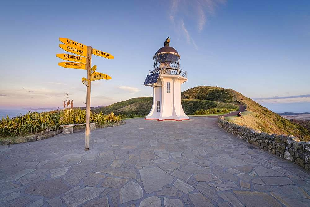 International signpost at the lighthouse at Cape Reinga in evening mood, Far North District, Northland, North Island, New Zealand, Oceania