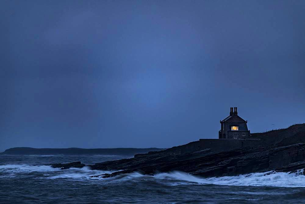 Small house on coast at blue hour, Berwick up on Tweed, Northumberland, Great Britain