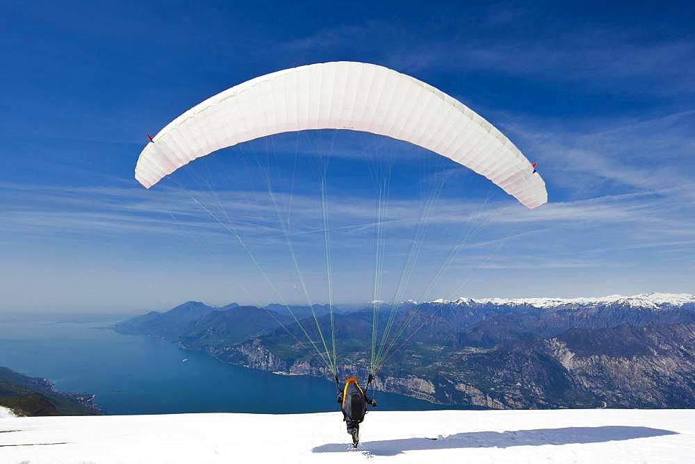 Launch of a paraglider on Monte Baldo above Lake Garda, Malcesine, Veneto, Italy, Europe