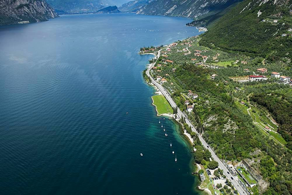 Lake Garda east shore with paragliding area near Malcesine, aerial view, Province of Veneto, Italy, Europe