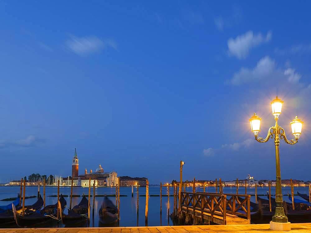 View of the church of San Giorgio Maggiore, in the foreground blue gondolas, Isola di San Giorgio Maggiore, Venice, Veneto, Italy, Europe
