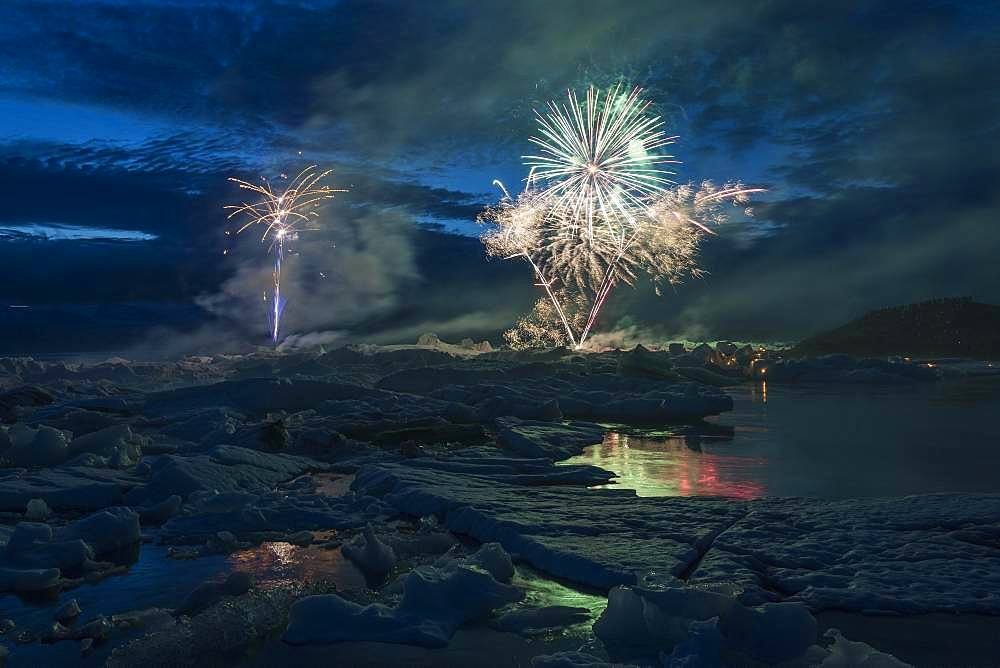 Annual fireworks over the glacier lagoon Joekulsarlon, South Iceland, Iceland, Europe