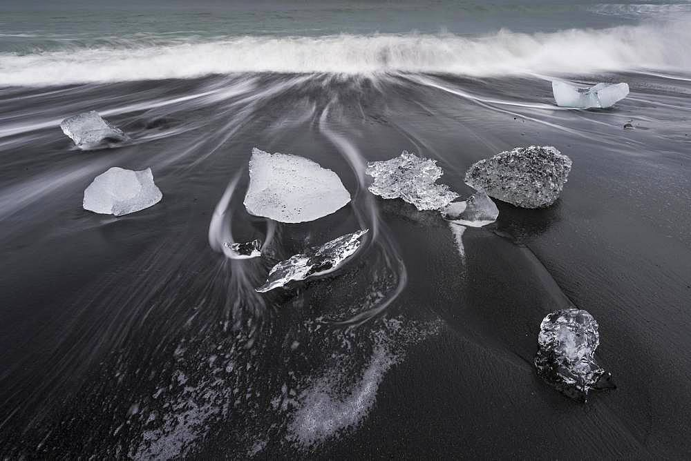 Surf and glacier ice on black beach, Joekulsarlon, South Iceland, Iceland, Europe
