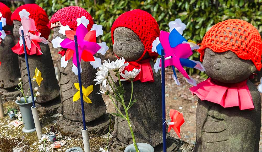 Jizo statues with red caps, protective deities for deceased children, Zojoji Temple, Buddhist temple complex, Tokyo, Japan, Asia